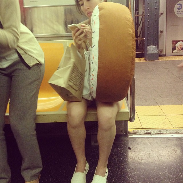 Texting through the hole. #1 reason to buy a doughnut pillow.