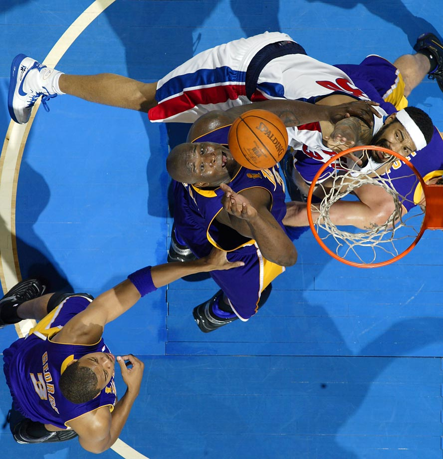 Shaquille O'Neal of the Lakers and Rasheed Wallace of the Pistons grapple for a rebound. Detroit impressively dispatched L.A.'s O'Neal-Kobe Bryant tandem in five games.