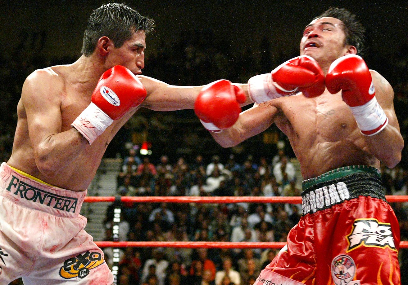 Moving up to super featherweight (130 pounds) for a showdown with Mexico's legendary three-division champion — the first installment of an epic trilogy — Pacquiao suffered a cut from an accidental butt in the fifth round and lost a unanimous decision.