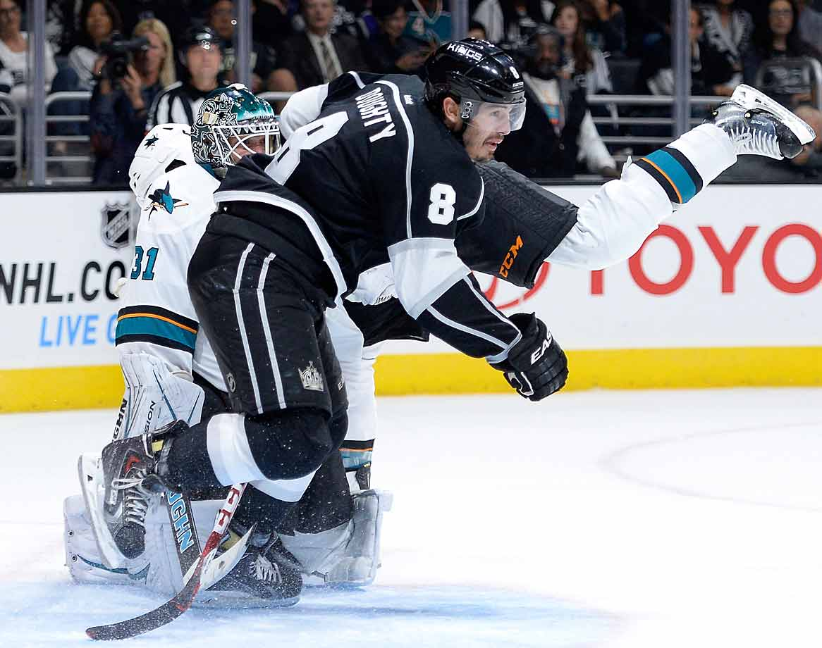 The Sharks got a leg up on defenseman Drew Doughty and the Kings during their season opener in Los Angeles. San Jose's 4-0 win exacted a measure of revenge for last spring's bitter playoff defeat at the hands of their Pacific Division rivals