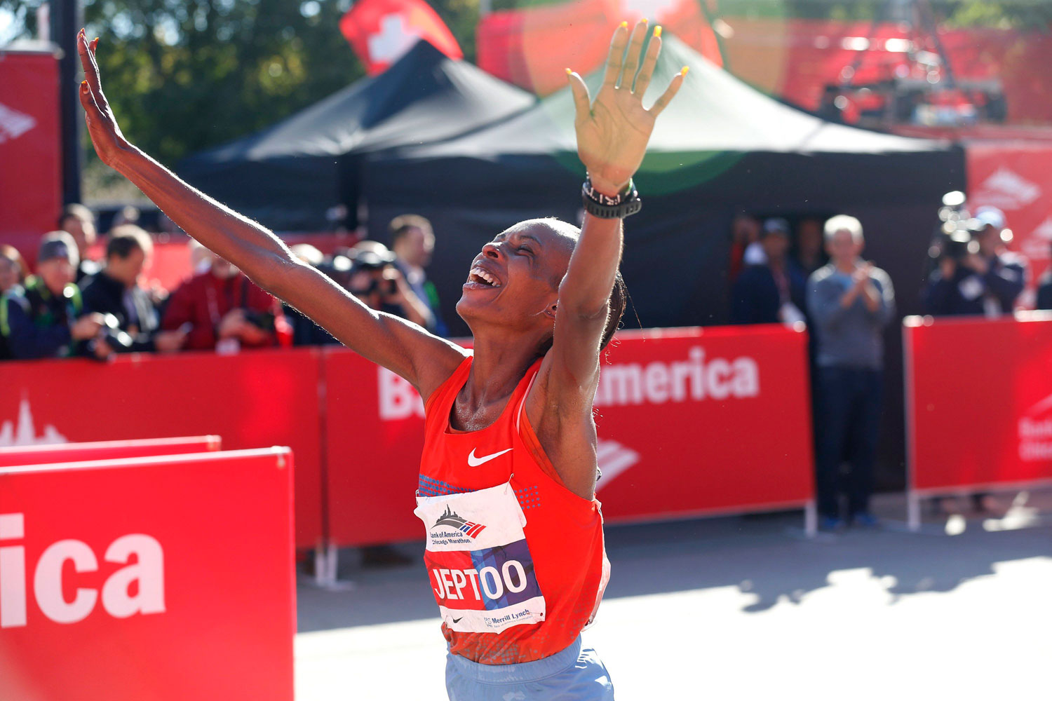Rita Jeptoo crosses the finish line to win the Bank of America Chicago Marathon in October 2013.