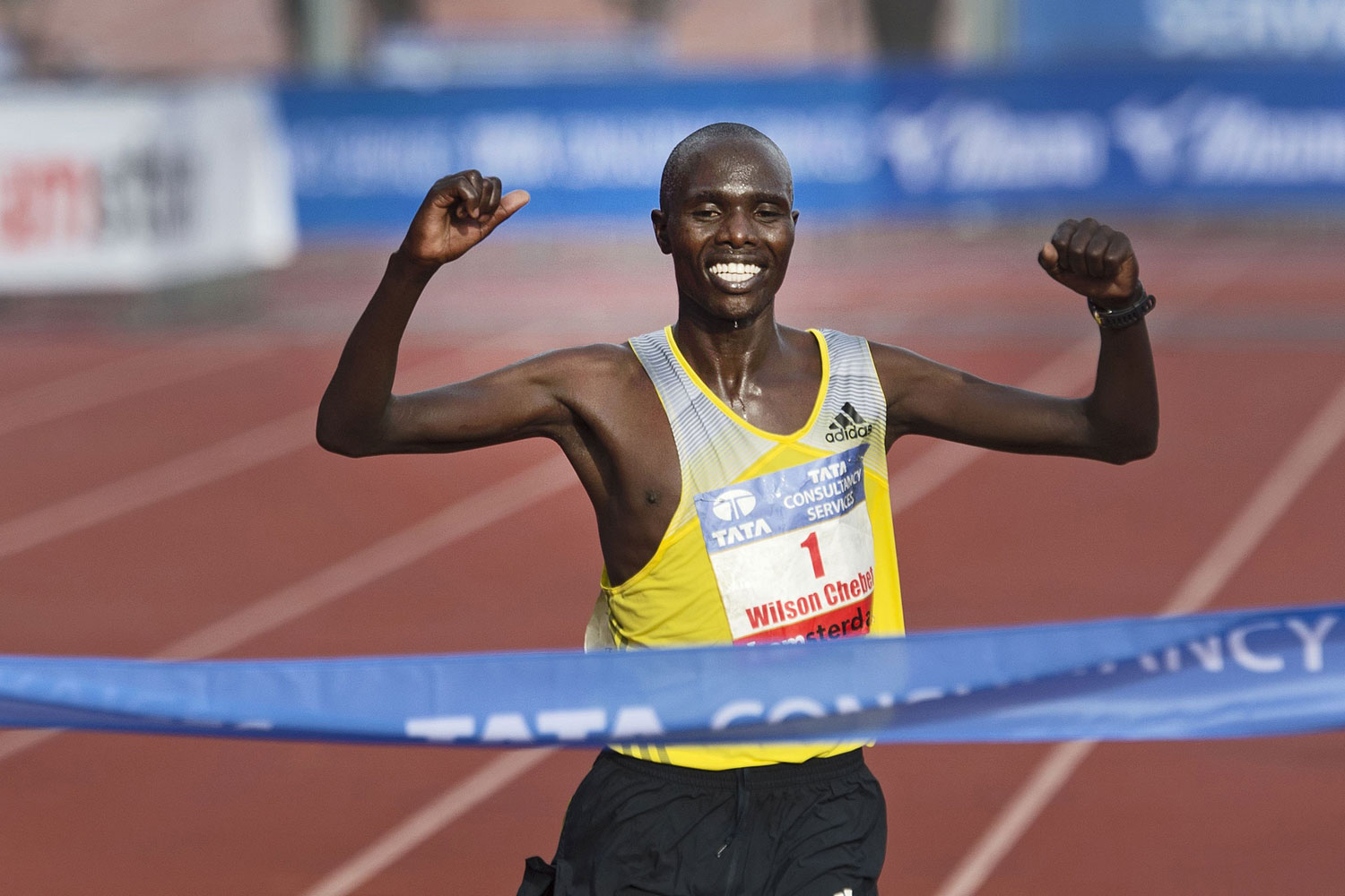 Wilson Chebet celebrates as he crosses the finish line to win the Marathon of Amsterdam on October 20, 2013.