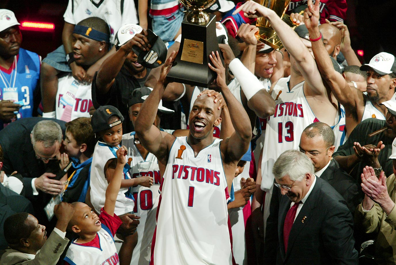 Chauncey Billups hoists the trophy as the Pistons celebrate their championship. With a penchant for making shots in critical moments, Billups was named Finals MVP.
