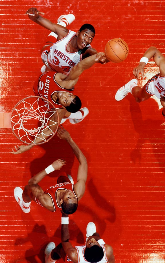 Houston's Akeem Olajuwon (34) and Louisville's Rodney McCray battle during a Final Four semifinal in Albuquerque. Houston won 80-68 in overtime and Olajuwon was later named Most Outstanding Player of the tournament.