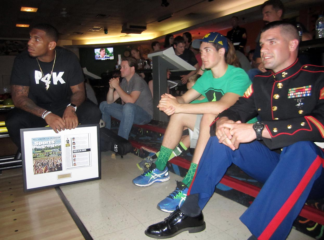 The whole crowd, including the Lions' Eric Ebron, Hunter, and Sgt. Scott Comment of the U.S. Marine Corps, watches SI's video about Hunter on the big screen at Forest View after the award presentation.