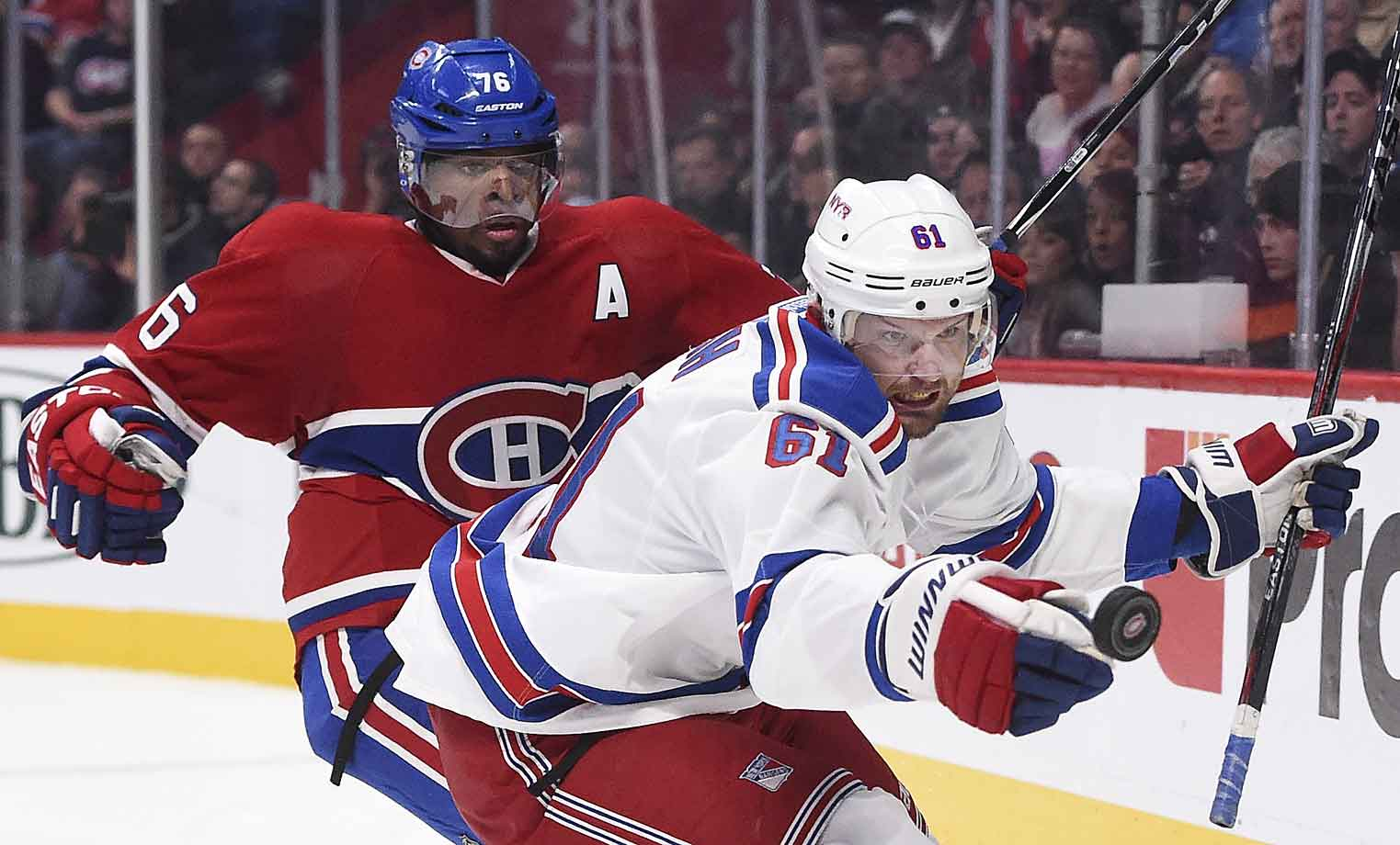 The Canadiens defenseman and the Rangers' red hot winger pursue that ever elusive puck at Montreal's Bell Centre on Oct. 25, 2014.