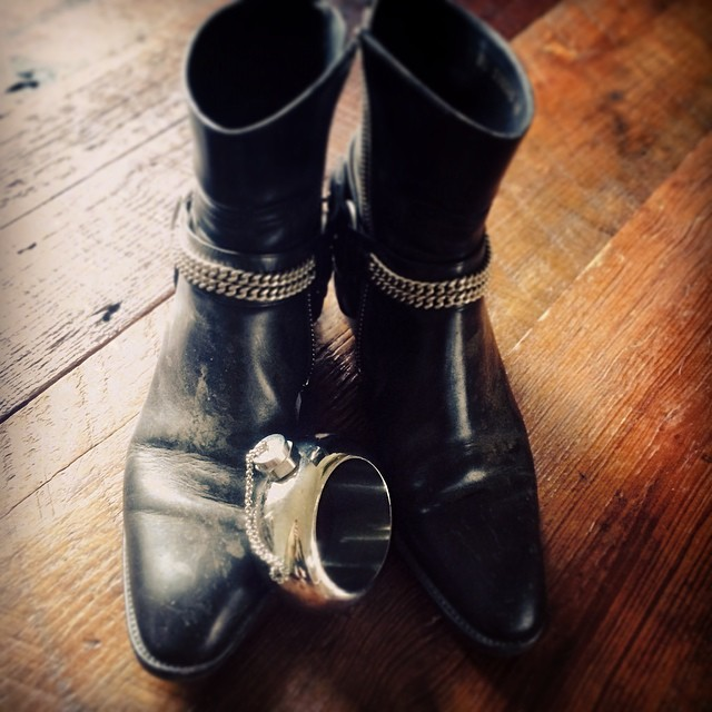 ACL essentials: Sh*t kickin' boots and an inconspicuous flask.