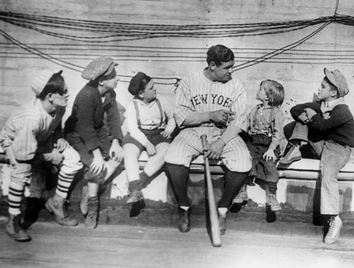 Ruth, the most popular athlete of his era, chats with a group of children in 1924.