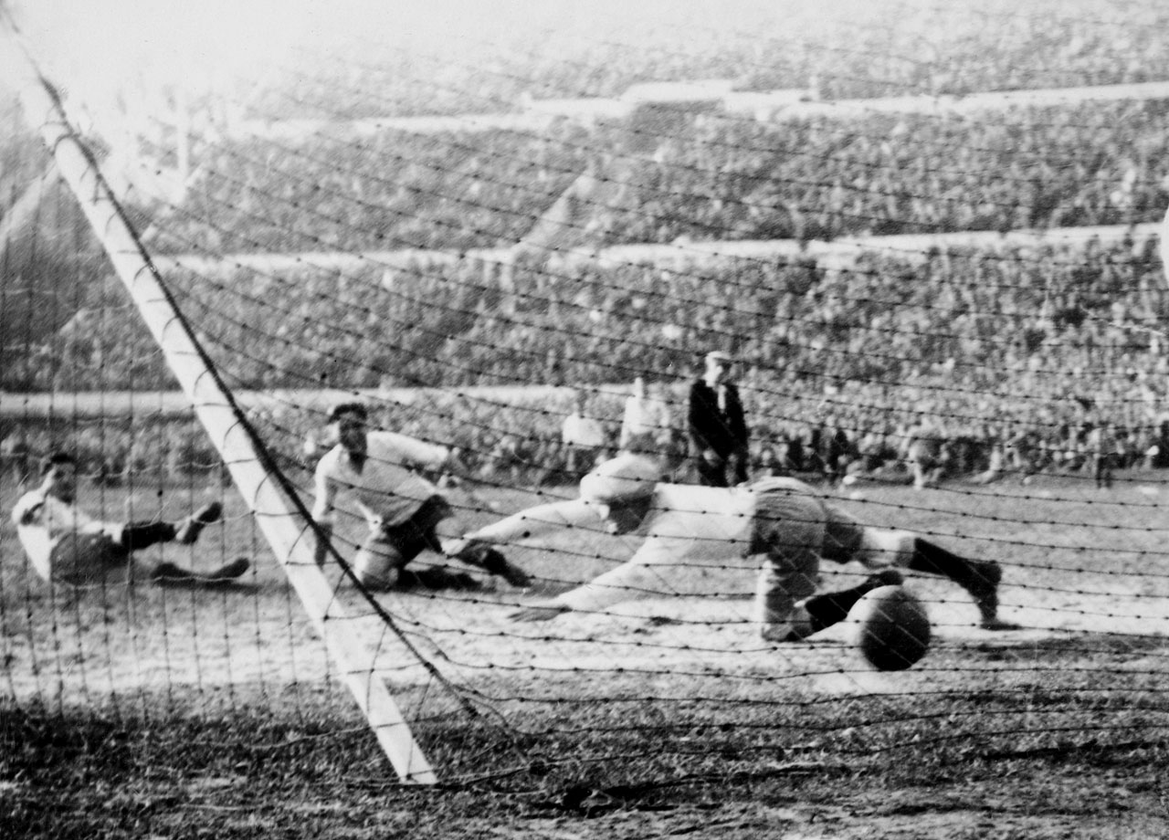 Pedro Cea beats Argentinian goalkeeper Juan Botasso en route to Uruguay's 4-2 victory in the first-ever World Cup final, held in 1930, on home soil.