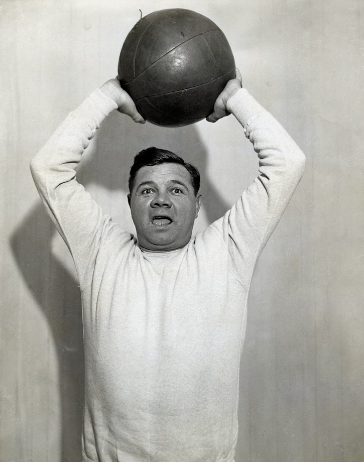 Babe Ruth hoists a medicine ball at McGoverns Gym in New York City in 1932.