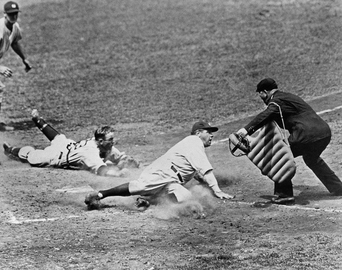 Babe Ruth slides safely into home during a Yankees-Tigers game in 1934.