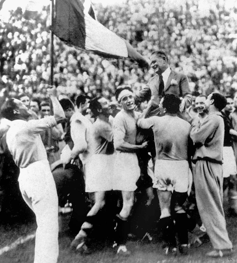 Vittorio Pozzo, captain of the Italian national team, celebrates a victorious World Cup held in his home country in front of then-ruler Benito Mussolini.