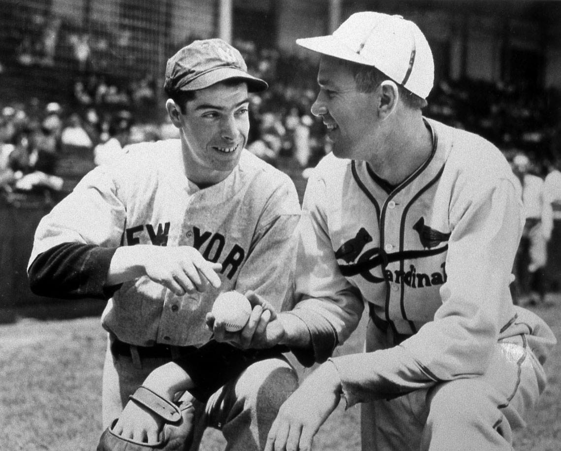 Joe DiMaggio chats with St. Louis Cardinals pitcher Dizzy Dean before the All Star Game on July 7, 1936 at Braves Field in Boston.
