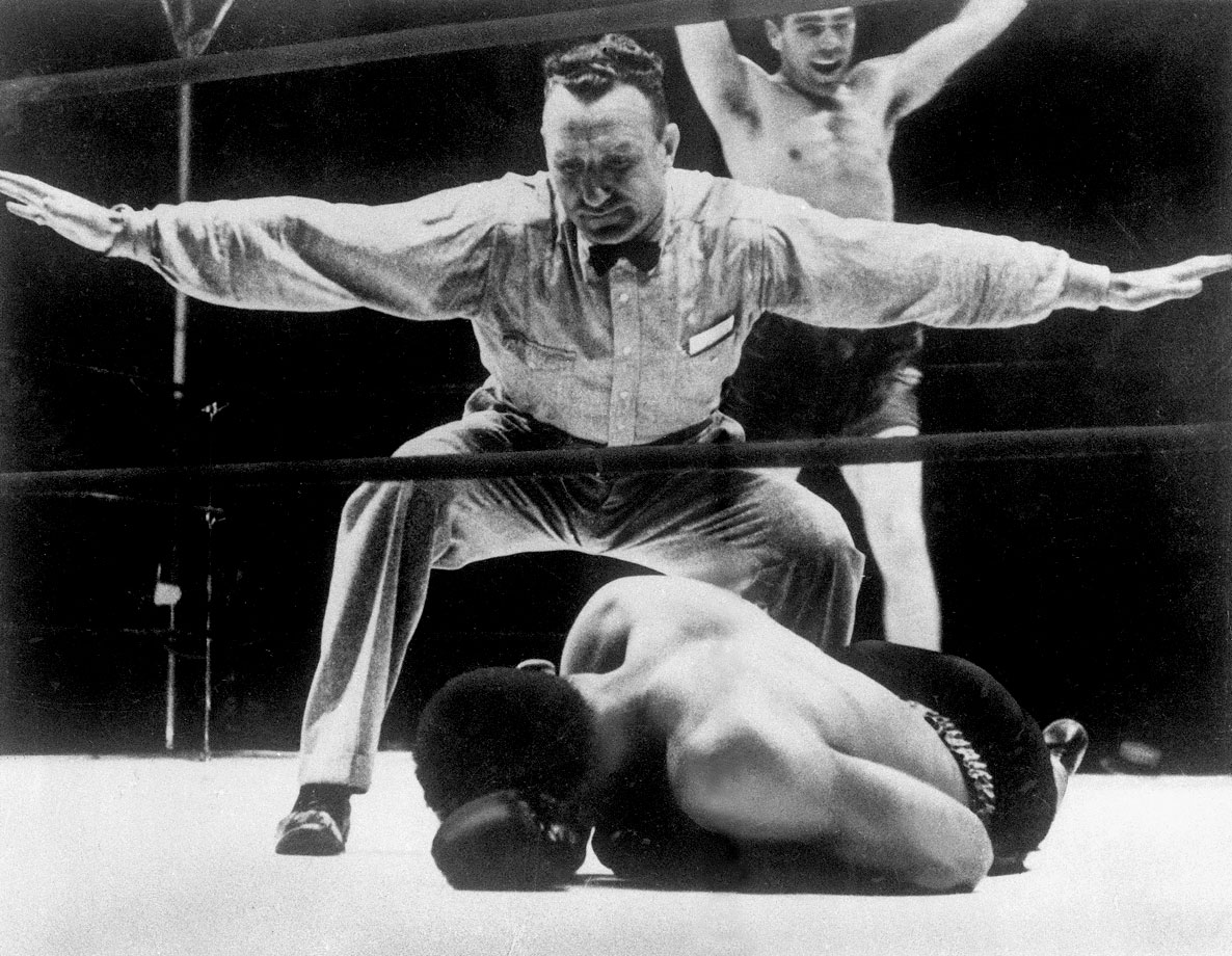 "Louis, with a record of 27-0 and ranked No.1, Louis signed to fight 30-year-old former champion Max Schmeling of Germany in what was regarded as a mere tune-up bout for Louis before he would face heavyweight champ James J. Braddock. Schmeling, though, was still a smart and dangerous fighter. Before the bout, he told reporters that he had watched films of Louis, adding cryptically, ""I see something."" (Printed in the papers, of course, as ""I zee zome-ting."" What he saw was Louis's tendency to drop his left hand after jabbing. Schmeling exploited that opening to land repeated right hands. He knocked Louis down for the first time in his career in the fourth and finished him off in the 12th in a finish that rocked the boxing world."