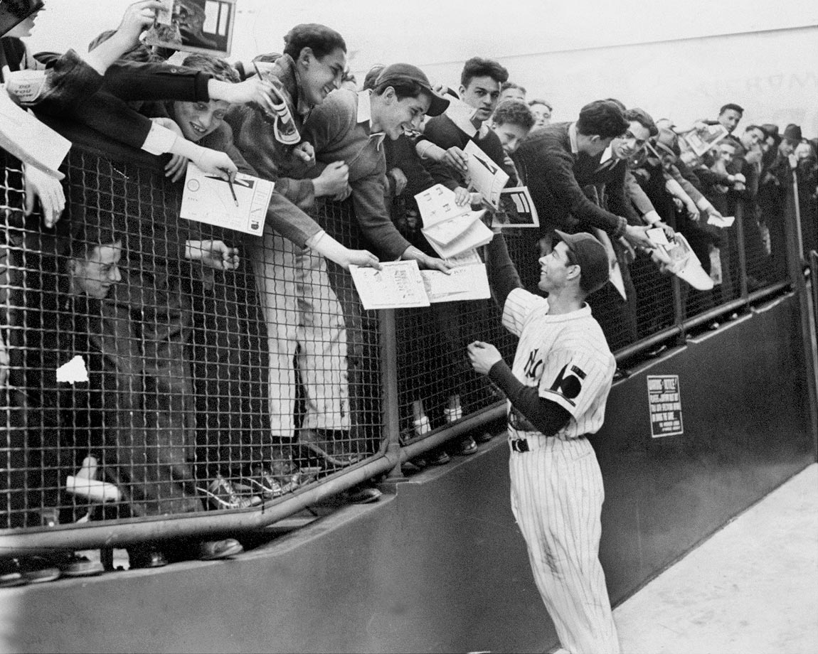 Joe DiMaggio greets fans and signs autographs on April 24, 1938.