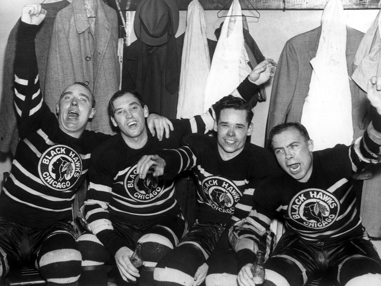 The Blackhawks set two NHL records in the 1938 final, playing three goaltenders (Alfie Moore, Paul Goodman and Mike Karakas) and eight American-born players on the way to the franchise's second Cup. Two of those Americans -- Carl Voss and Cully Dahlstrom -- were bookended by Jack Shill and Harold 'Mush' March in celebration after they defeated the Toronto Maple Leafs, 4-1, in Game 4.