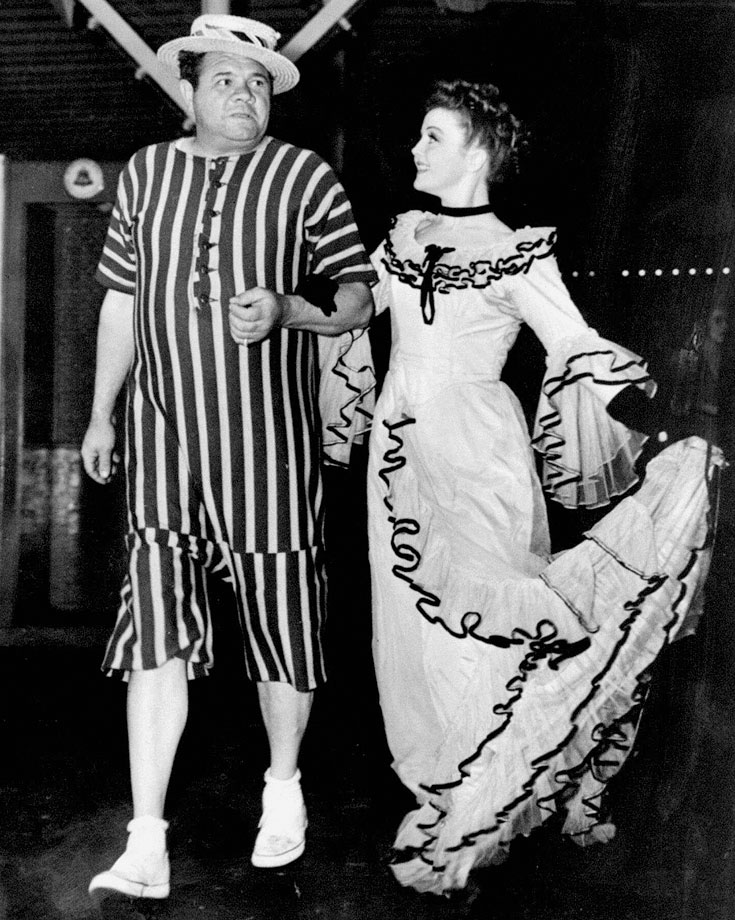 Babe Ruth and Nancy Carroll, stars of the Broadway play ''I Must Love Someone,'' attend the annual roller skating party in Coney Island.