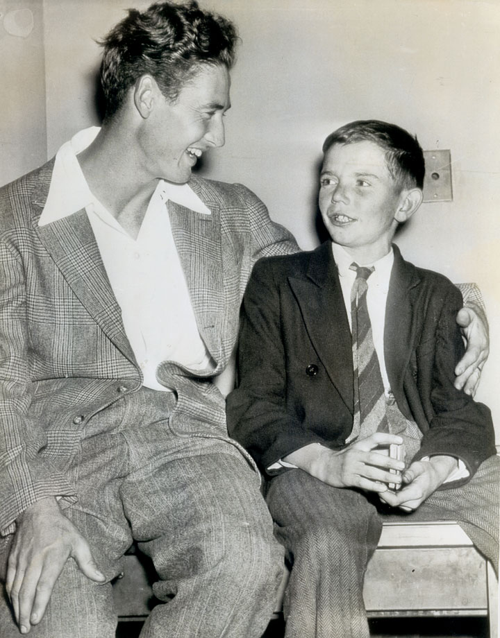 A young fan sits down for a chat with Ted Williams at Fenway Park in 1941, after hitchhiking 250 miles to Boston to meet his hero.