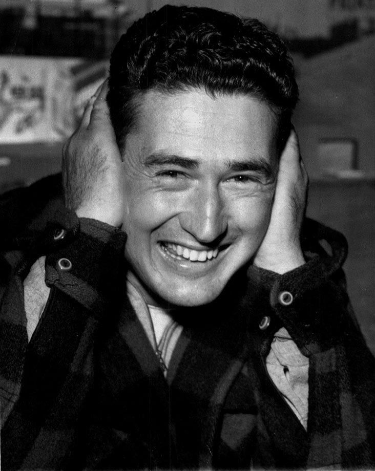 Ted Williams covers his ears, joking around on a fishing trip in 1942.