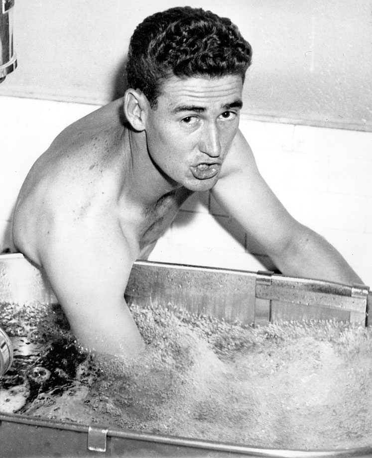 Ted Williams soaks his injured elbow in a hydrotherapy tank in 1946.