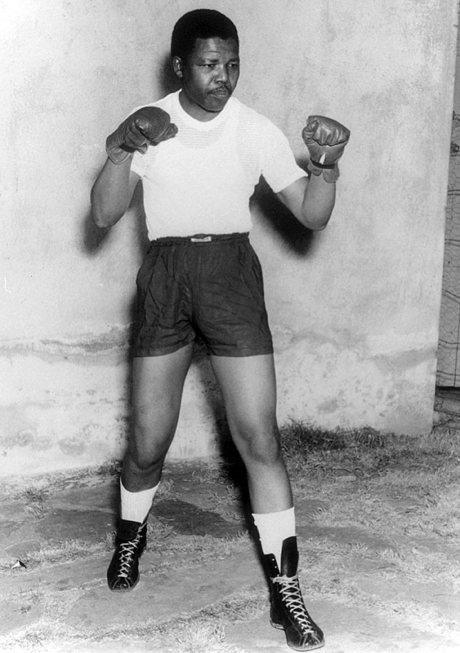 Mandela, who had boxed as an amateur heavyweight, poses after joining the African National Congress (ANC).