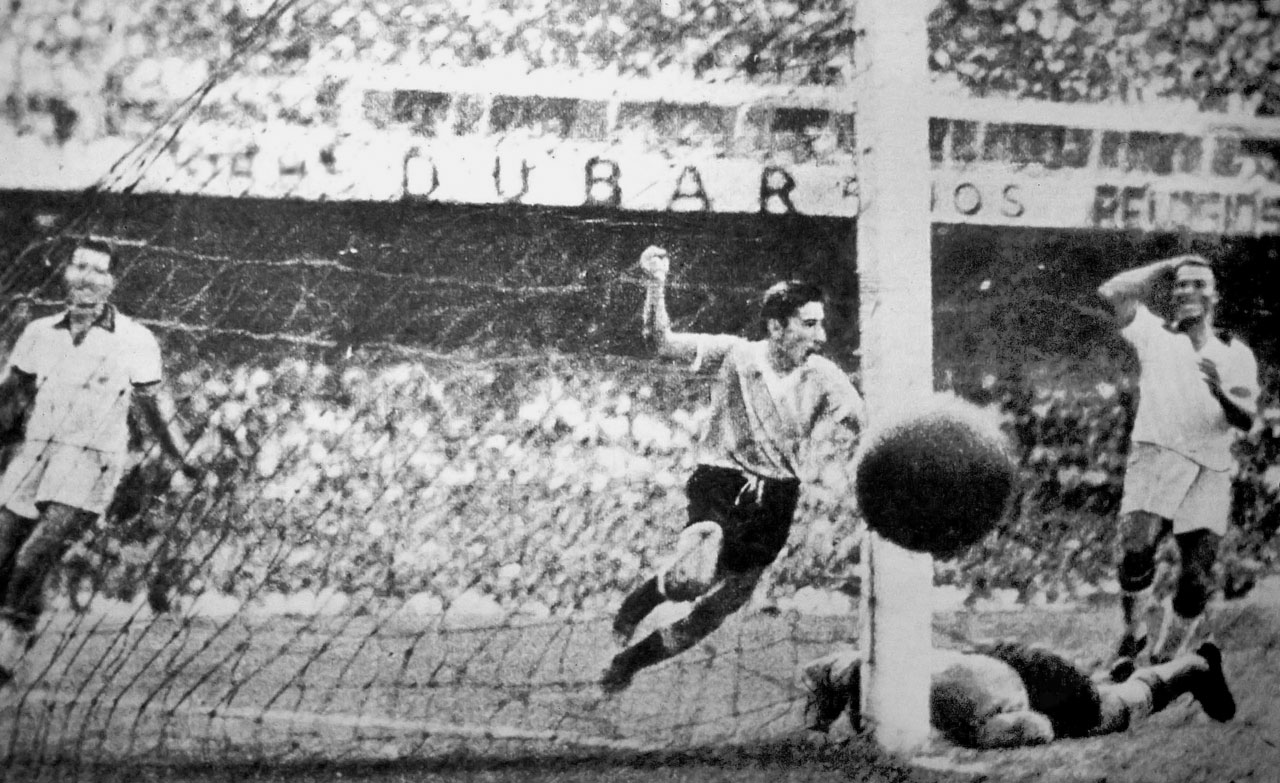 Uruguayan Alcides Ghiggia celebrates in front of a hostile crowd at the Maracana in Rio de Janeiro as Uruguay upsets the heavily-favored hosts Brazil to win its second World Cup trophy, in 1950.