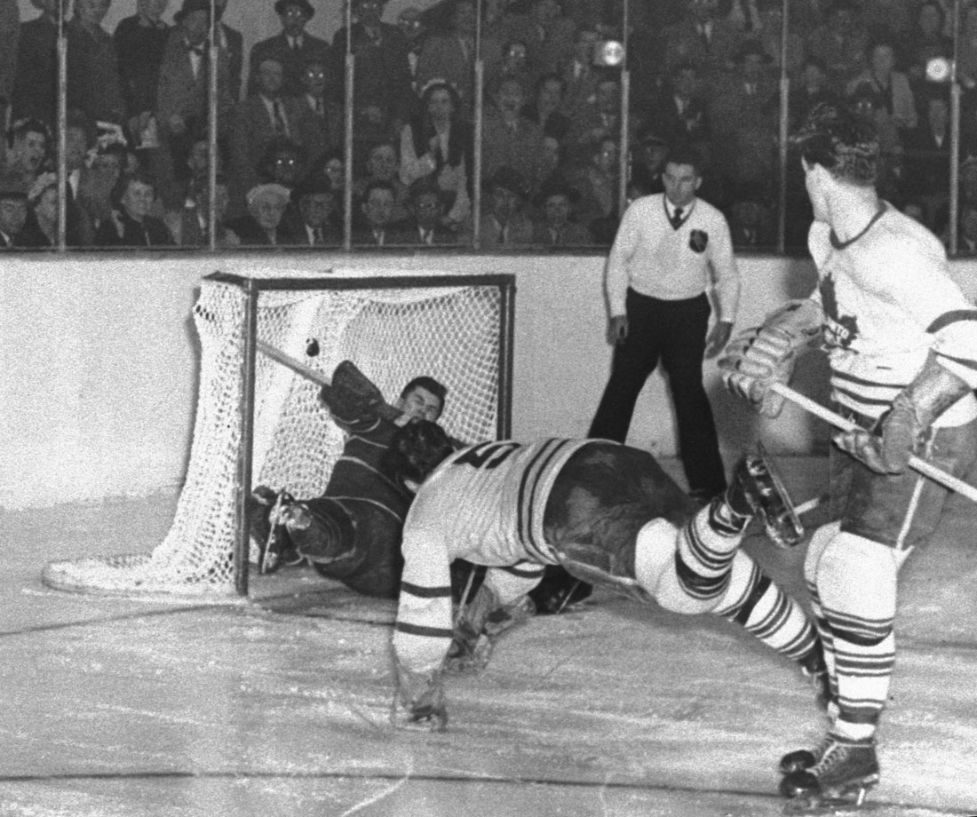 """The image of Toronto's Bill Barilko scoring the Cup-winning goal against Montreal's Gerry McNeil in overtime of Game 5 is arguably the most iconic ever captured on Canadian ice. It was preserved in the 1951-52 Parkhurst hockey card series after Barilko died in an offseason plane crash that year, the tragedy deeply affecting generations of fans. Among them: Gord Downie of The Tragically Hip, who wrote the band's classic song """"50 Mission Cap"""" in Barilko's honor."""