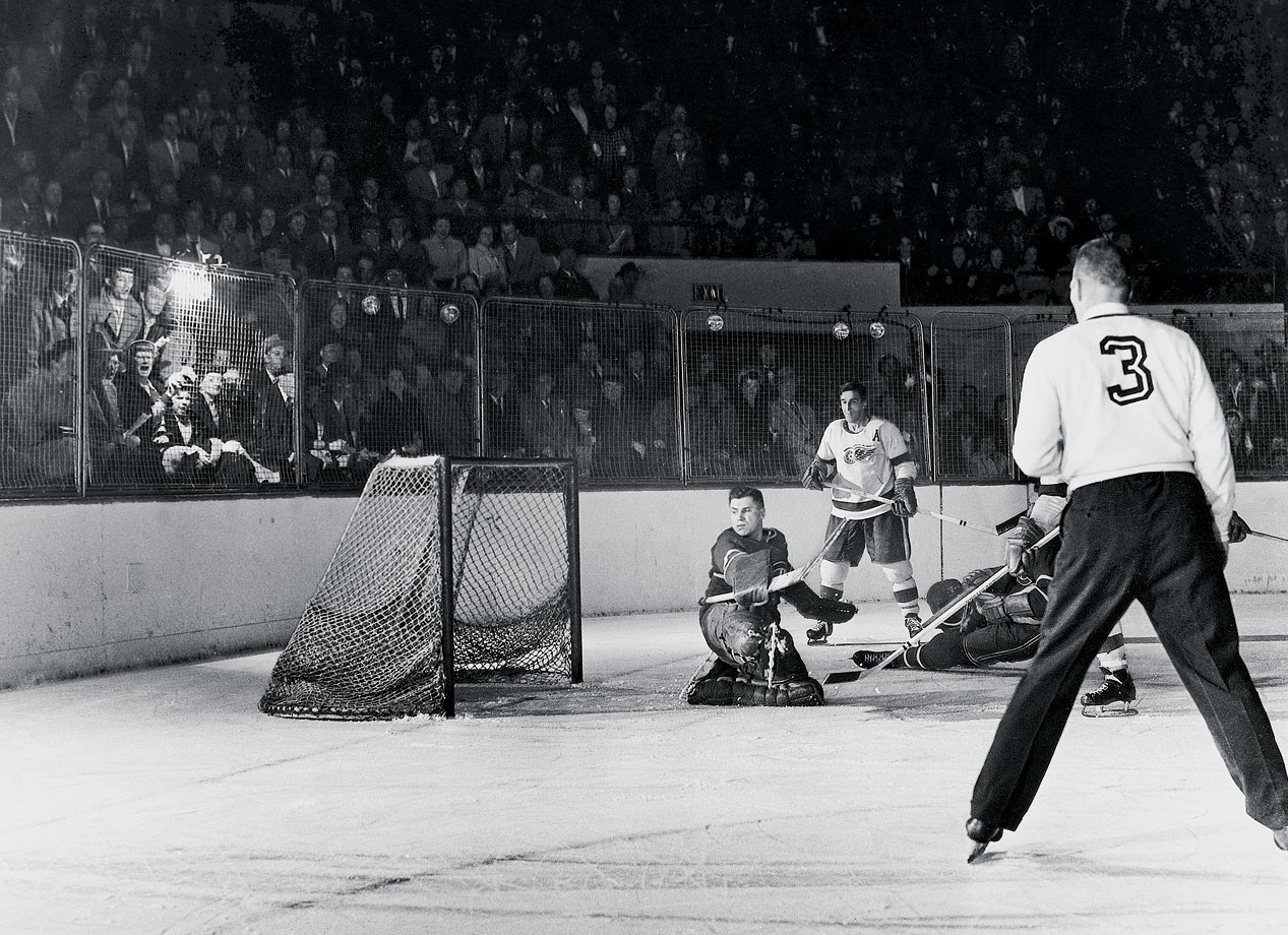 Montreal's goalie Gerry McNeil had no chance on this Game 3 shot by Gordie Howe, one of two goals that Mr. Hockey scored in his first appearance in a Stanley Cup Final. Howe and Terry Sawchuk, who pitched two shutouts and allowed just two goals in the series, guided the Red Wings to a four-game sweep of the Habs and the first undefeated postseason in league history.
