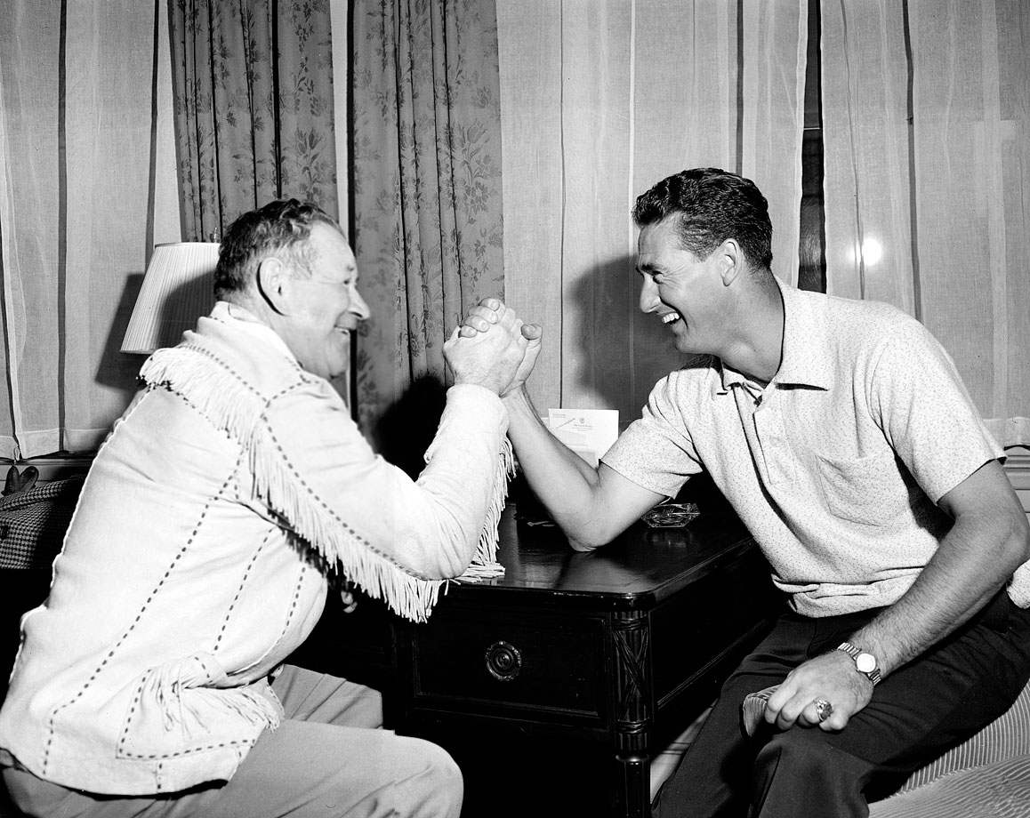 Jim Thorpe and Ted Williams engage in an arm-wrestling match in New York City in 1952.