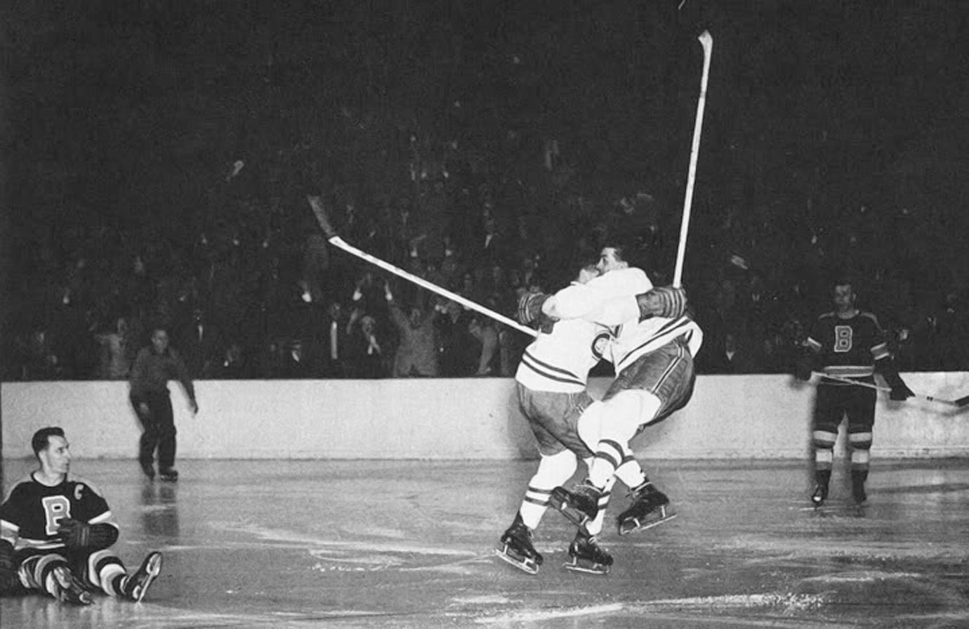 This iconic shot was taken as Montreal's Elmer Lach (left) and linemate Rocket Richard embraced after Lach delivered an overtime, Cup-clinching dagger to the Boston Bruins in Game 5.