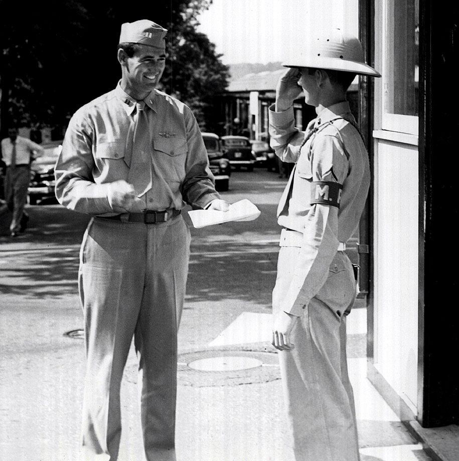 Ted Williams checks out with the guard at the Marine barracks in Washington D.C. after being released from active duty in 1953.
