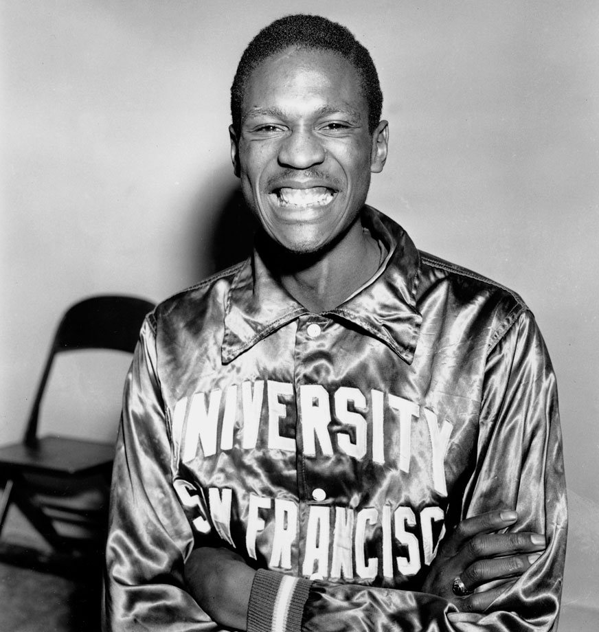 Bill Russell poses for a photo a month before he would lead the University of San Francisco to the first of back-to-back championships.