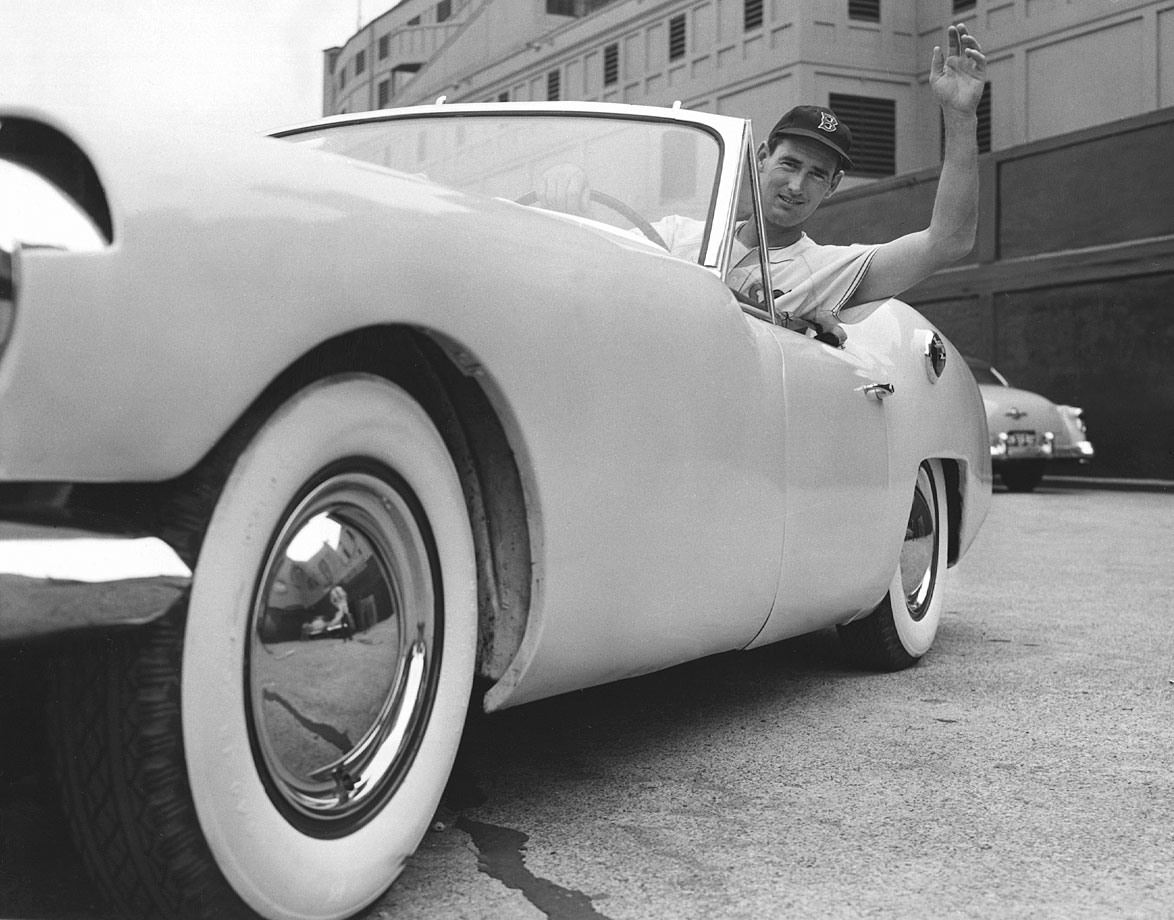 Ted Williams waves from one of his cars in 1955.