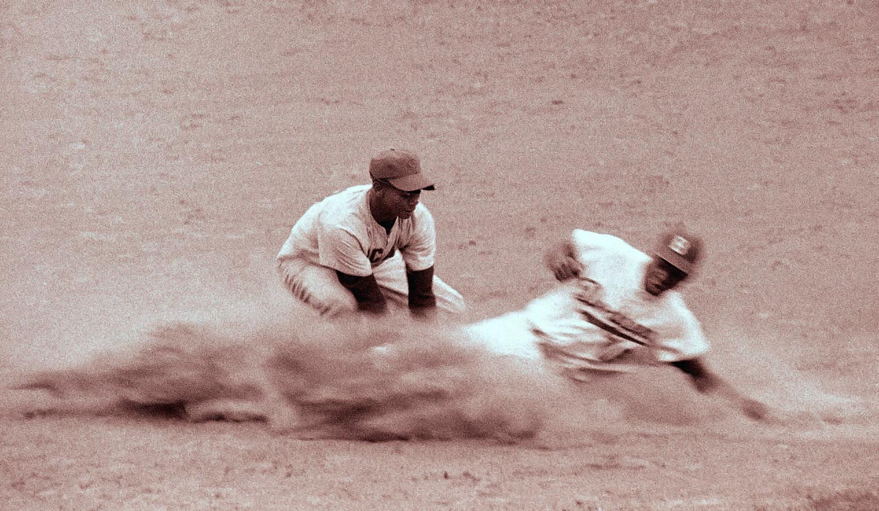 Ernie Banks makes the tag on Jim Gilliam of the Brooklyn Dodgers.