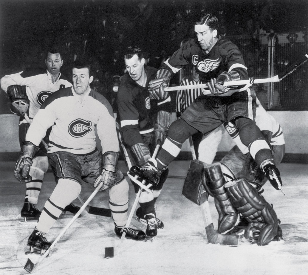 Detroit's Ted Lindsay (jumping) and Gordie Howe crowded the crease of Montreal goalie Jacques Plante while defenseman Doug Harvey (back left) and Claude Provost battled to hold the fort. Plante held Detroit to just 10 goals in that series as the Canadiens closed out Detroit in five games and launched a five-year dynasty.