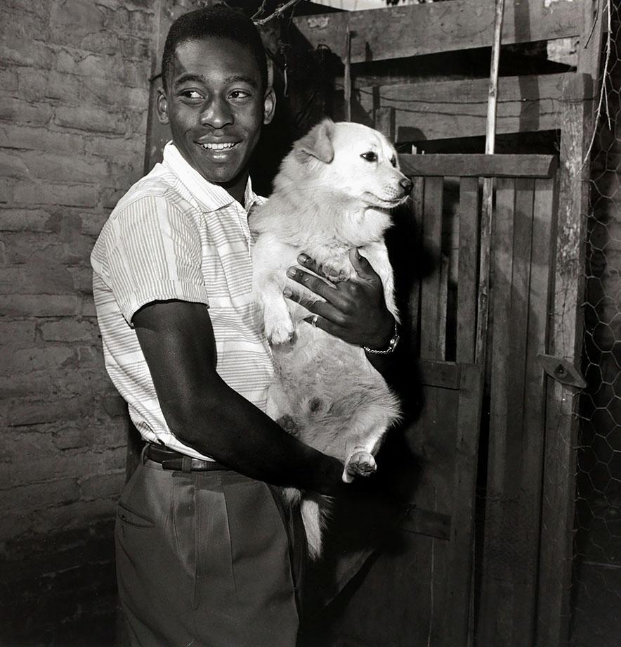A boyish-looking Pelé cradles a puppy circa 1958.