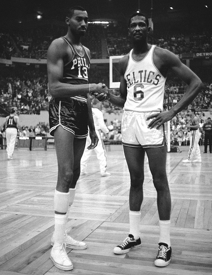 Wilt Chamberlain shakes hands with Bill Russell before a game. The rivals battled repeatedly in the postseason, with Russell's team usually coming out on top.