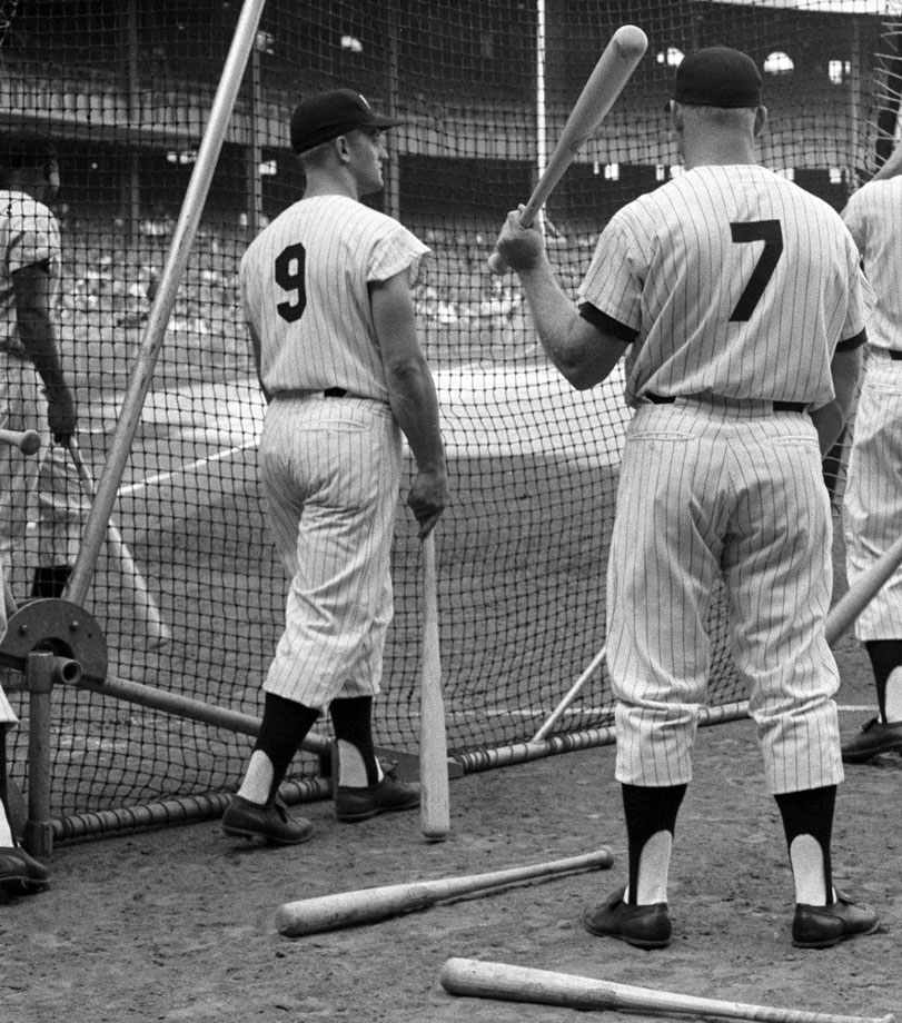 Roger Maris and Mickey Mantle look on during batting practice before the Yankees' game against the Cleveland Indians at Yankee Stadium on Aug. 26, 1960.