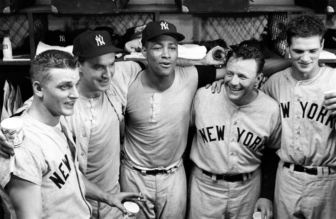 Roger Maris, Johnny Blanchard, Elston Howard, manager Ralph Houk and winning pitcher Ralph Terry celebrate in their locker room after clinching the AL pennant with a win over the Orioles at Memorial Stadium in Baltimore on Sept. 20, 1961. Maris hit his 59th season home run in the game.