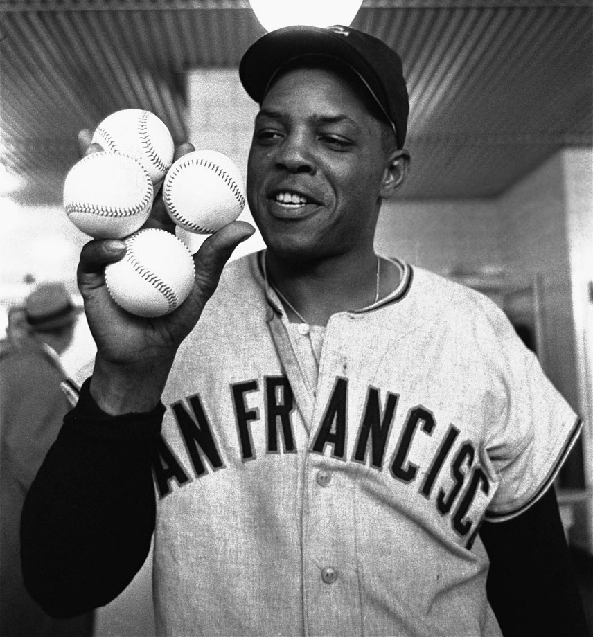Mays outslugged Hank Aaron, who had two homers of his own, in the San Francisco Giants' 14-4 win over the Milwaukee Braves.