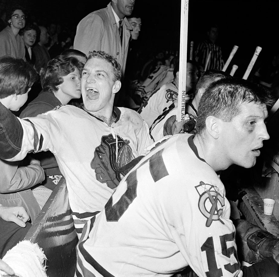After splitting the first four games of the series, Bobby Hull and the Blackhawks routed the Red Wings in Games 5 and 6 to capture their first Cup in 23 years. Hull, seen here shouting to a fan at Detroit's Olympia in the final moments of Chicago's series-clinching victory, tallied twice in the series.