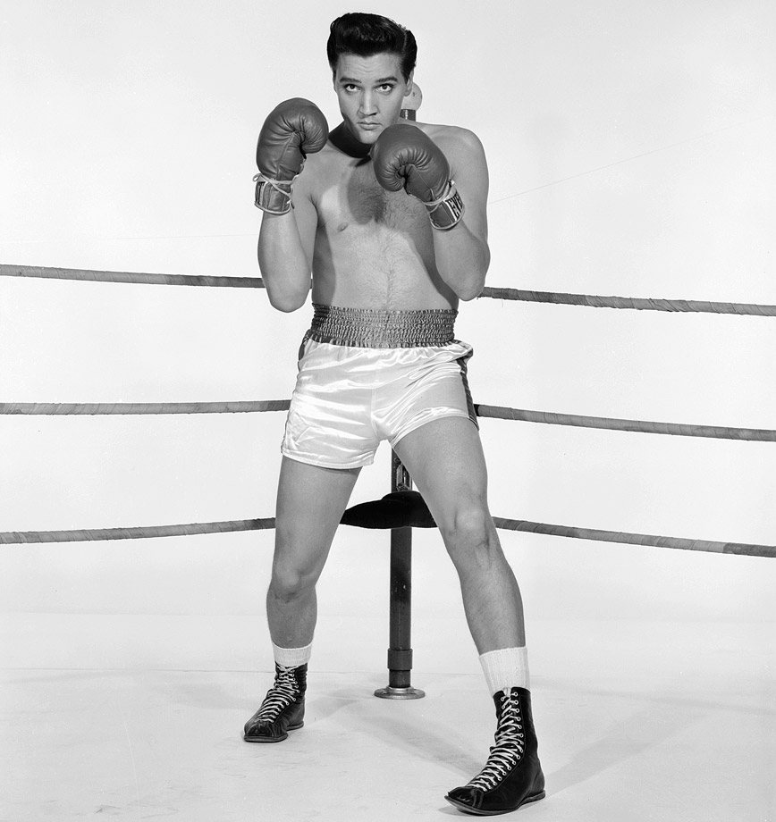 "Elvis Presley poses as his character Walter Gulick in the film ""Kid Galahad"" in 1962."
