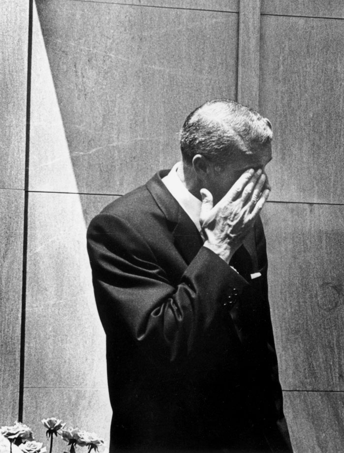 Joe DiMaggio wipes a tear from his eye at the funeral of Marilyn Monroe in Westwood Memorial Park in Hollywood, Calif. He was the second of Monroe's three husbands.