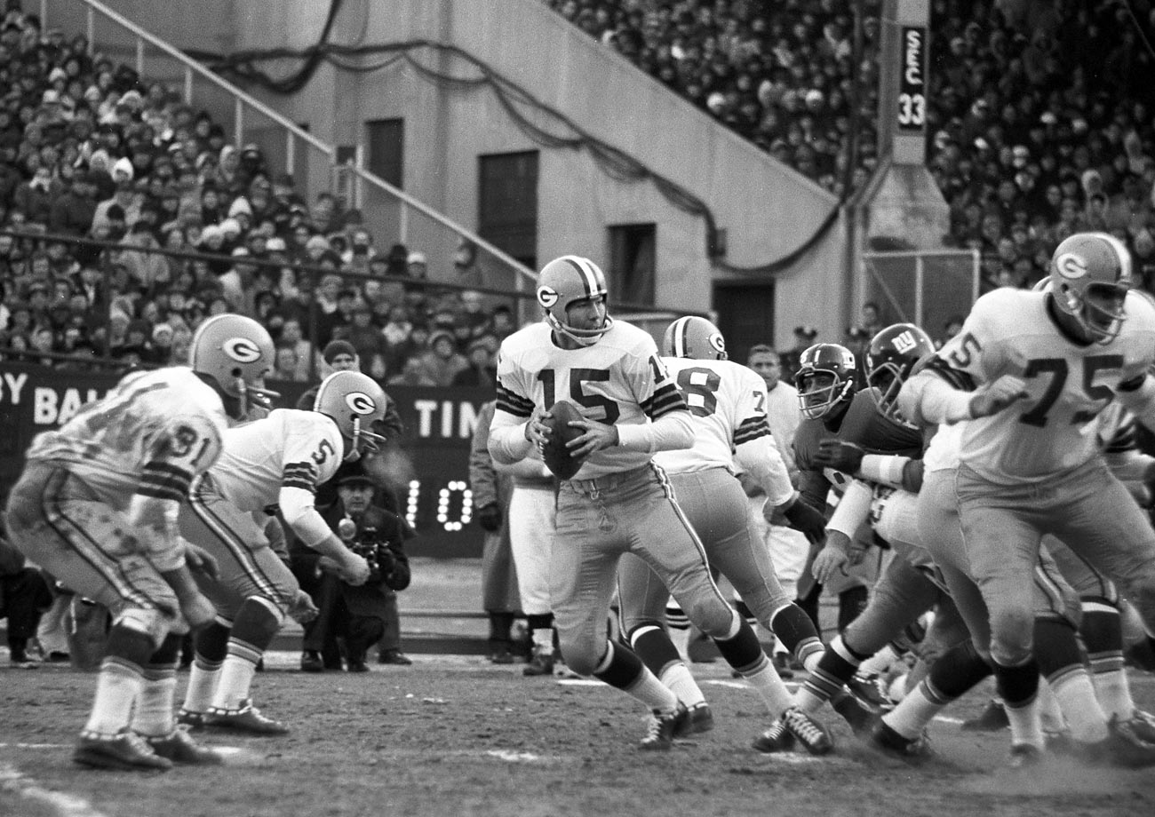 "In the 1962 title game against the Giants (a rematch of the 1961 championship game), the weather was terrible. Starr noted, ""Several times we noted that the benches on the sideline, those heavy benches that they sat on over there, they were blown over during the course of the game."" TV crews made bonfires to thaw out their cameras, and one cameraman suffered frostbite. (Text credit: Shannon Carroll)"