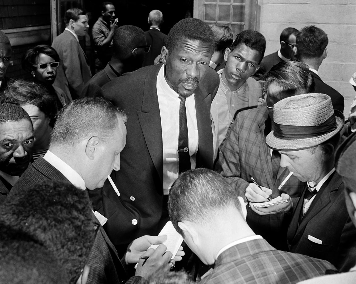 Bill Russell talks with the media after speaking with an estimated 3,000 children who had boycotted Boston Public Schools that day to protest what parents said was actual -- if not legal -- segregation. Russell has worked toward racial equality during his life.
