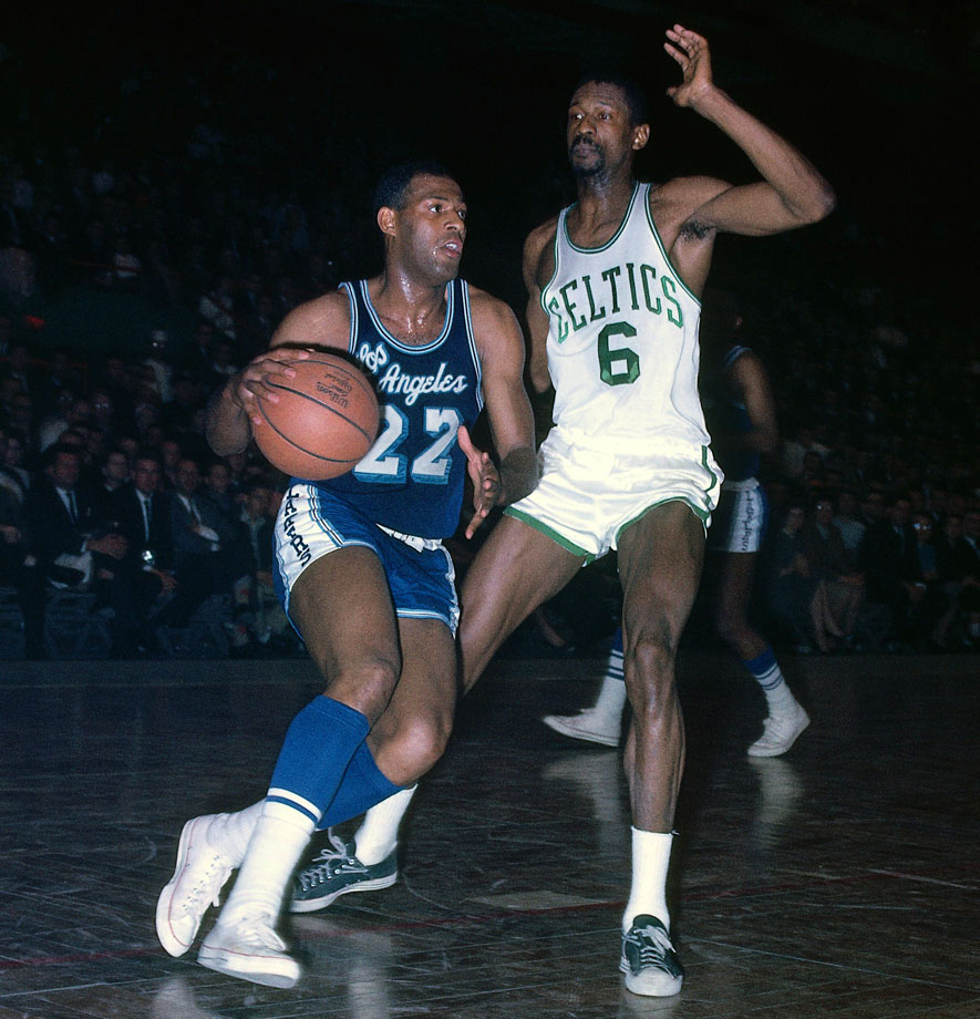 Hall of Famer Elgin Baylor dribbles up court against Russell. Russell defeated Baylor's Lakers for seven of his 11 NBA championships.