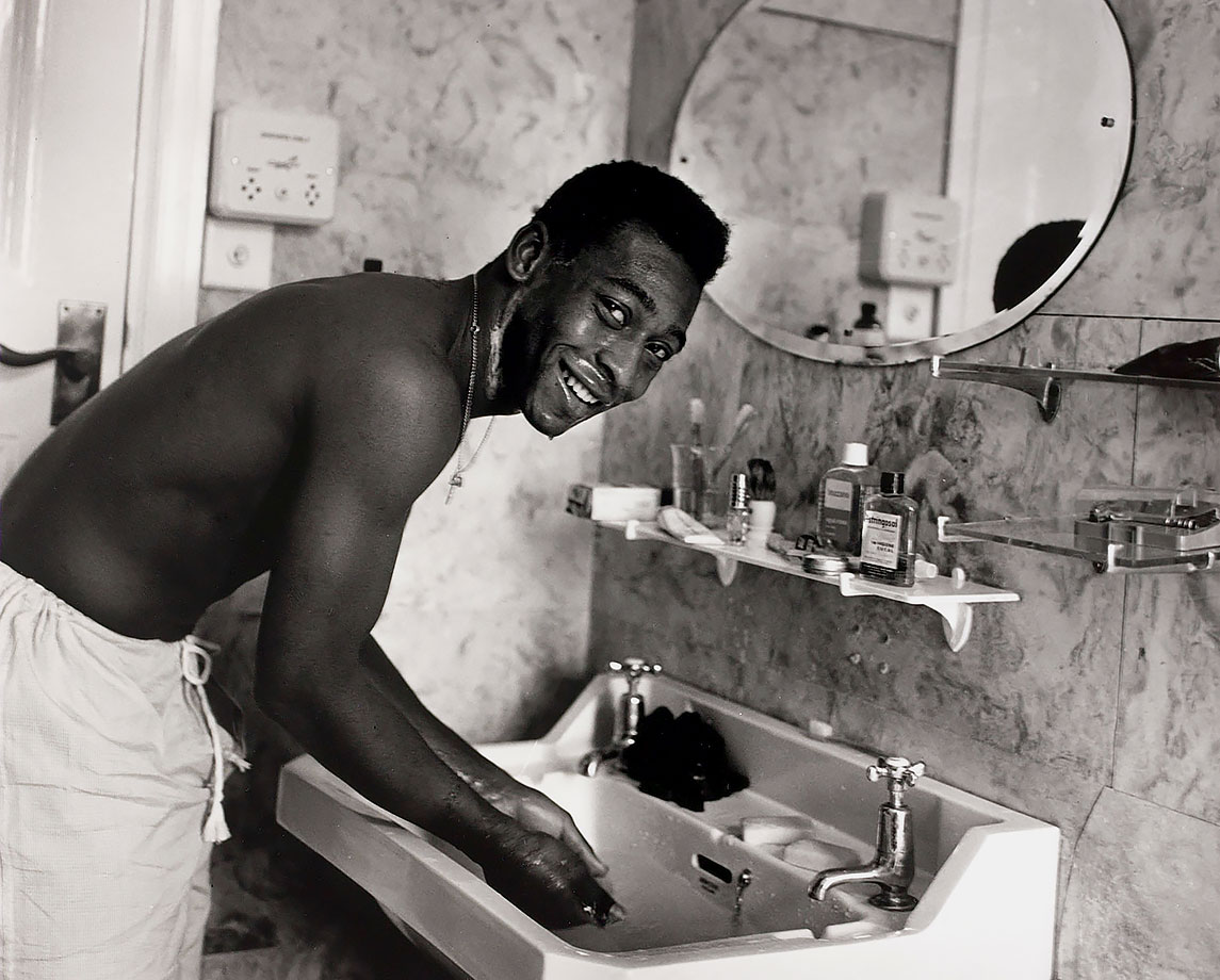 Pelé smiles while washing in the bathroom in May 1963. He was a media target everywhere he went, becoming the most legendary footballer ever.