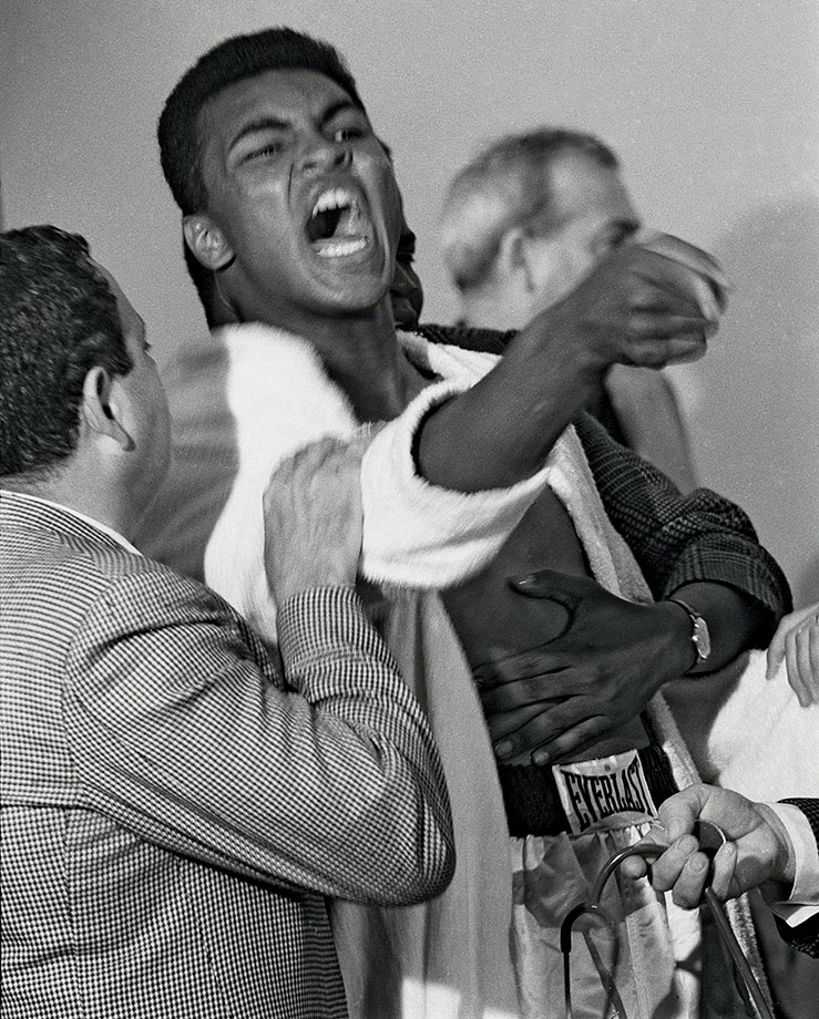 "A seemingly hysterical Clay taunted Sonny Liston during the pre-fight physical for their 1964 bout. He had consistently baited the Big Bear during the lead-up to the fight, saying he was going to ""use him as a bearskin rug ... after I whup him."" The Miami Boxing Commission would fine Clay $2,500 for his outburst at the physical."