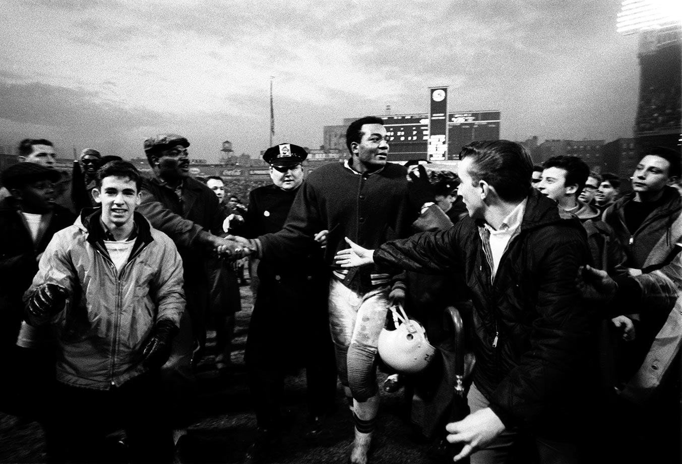 Jim Brown walks off the field after the Cleveland Browns dominated the New York Giants 52-20 in 1964. The victory capped off a 10-3-1 regular season that sent the Browns to the NFL Championship Game.