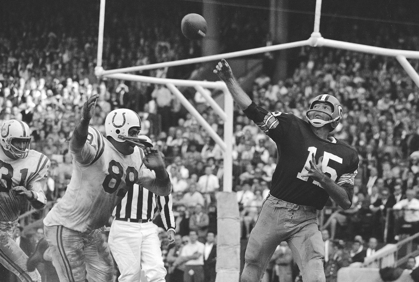 In 1964, the Packers again finished second in the Western Conference, this time behind the Baltimore Colts. Over the season, Starr completed 59.9% of his passes and had 15 touchdowns to just four interceptions. (Text credit: Shannon Carroll)